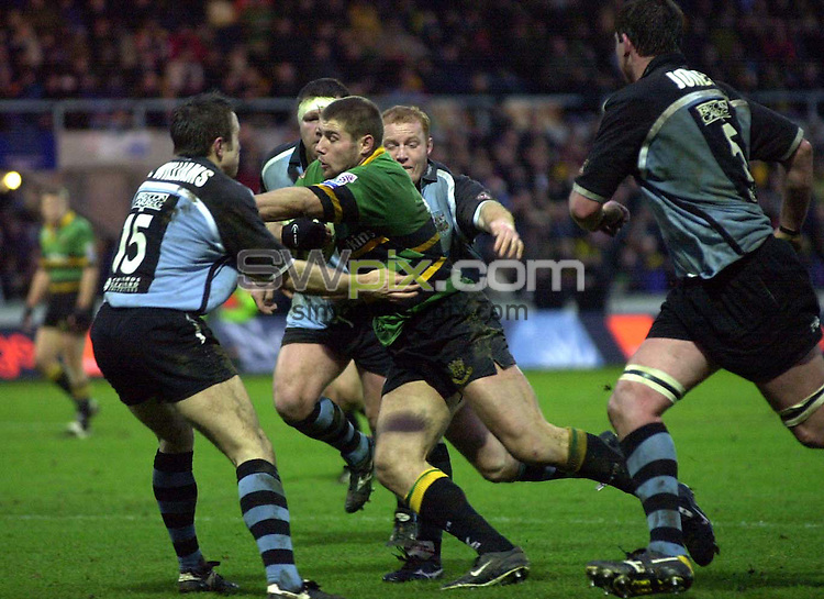 Pix: Matthew Lewis/SWpix.com. Rugby Union. Heineken Cup. Round Three. Northampton v Cardiff. 07/12/2002...COPYWRIGHT PICTURE>>SIMON WILKINSON>>01943 436649>>..Northampton's Ben Cohen breaks through the Cardiff defence.
