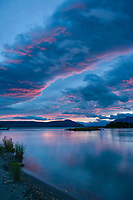 Colorful morning sunrise over the Brooks river and Naknek lake, Katmai National Park, Alaska.