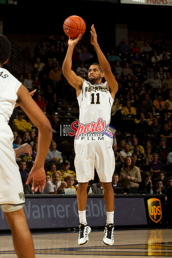 C.J. Harris (11) of the Wake Forest Demon Deacons fires up a jump shot during first half action against the Seton Hall Pirates at the LJVM Coliseum on December 8, 2012 in Winston-Salem, North Carolina.  The Pirates defeated the Demon Deacons 71-67.    (Brian Westerholt/Sports On Film)