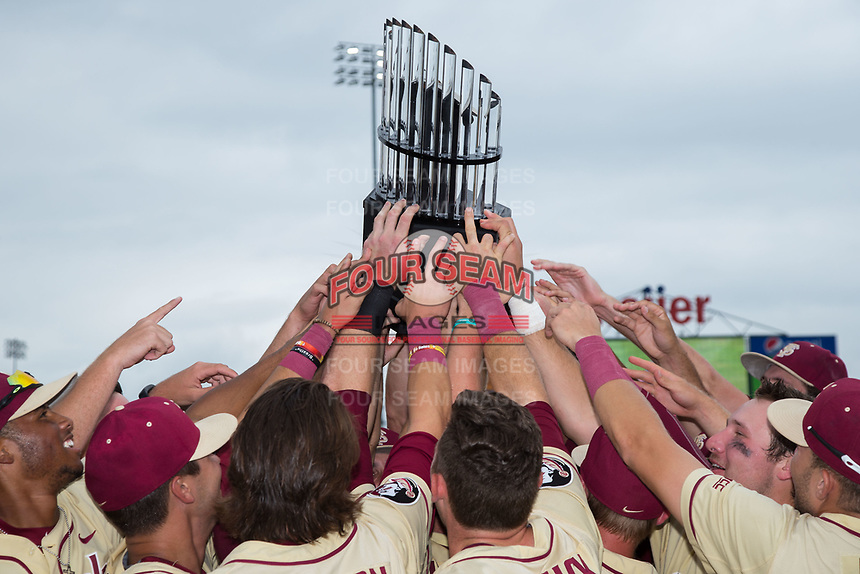 The Florida State Seminoles hoist the championship trophy into the air following their win over the North Carolina Tar Heels during the 2017 ACC Baseball Championship Game at Louisville Slugger Field on May 28, 2017 in Louisville, Kentucky.  The Seminoles defeated the Tar Heels 7-3.  (Brian Westerholt/Four Seam Images)