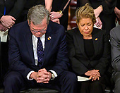 Former Governor Jeb Bush (Republican of Florida) and his wife, Columba, bow their heads in prayer during the ceremony honoring former United States President George H.W. Bush, who will Lie in State in the Rotunda of the US Capitol on Monday, December 3, 2018.<br /> Credit: Ron Sachs / CNP<br /> (RESTRICTION: NO New York or New Jersey Newspapers or newspapers within a 75 mile radius of New York City)