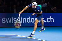 27th October 2019; St. Jakobshalle, Basel, Switzerland; ATP World Tour Tennis, Swiss Indoors Final; Alex de Minaur (AUS) serves the ball in the match against Roger Federer (SUI)  - Editorial Use
