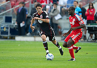 August 21 2010   D.C. United forward Pablo Hernandez #21 and Toronto FC defender Nana Attakora #3 in action during a game between DC United and Toronto FC at BMO Field in Toronto..DC United won 1-0.