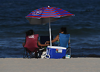 POMPANO BEACH, FL - JULY 31: People are seen on Pompano Beach as Hurricane Isaias tracks towards Florida in addition to Florida reporting more than 9,007 new COVID-19 cases Friday and 257 deaths on July 31, 2020 in Pompano Beach, Florida. Credit: mpi04/MediaPunch