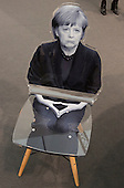 London, England. 14 October 2014. An Angela Merkel chair by Goshka Macuga, Kate MacGarry Gallery. Frieze Art Fair 2014 opens in Regent's Park, London. Photo: Bettina Strenske