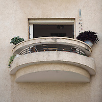 A balcony on the Bauhaus style Zitter House at 6 Mendelsohn Street built by architect Gershon Stempler in 1937. Tel Aviv is known as the White City in reference to its collection of 4,000 Bauhaus style buildings, the largest number in any city in the world. In 2003 the Bauhaus neighbourhoods of Tel Aviv were placed on the UNESCO World Heritage List. .