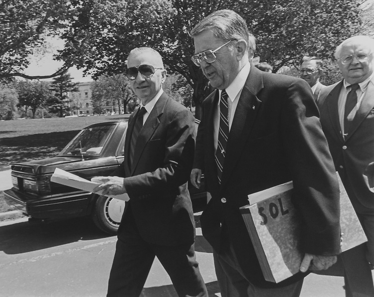 Ross Perot and Rep. Gerald B. H. Solomon, R-N.Y., walk over to a press conference in House regarding the A-to-Z Spending Cuts Plan on April 21, 1994. (Photo by Maureen Keating/CQ Roll Call via Getty Images)