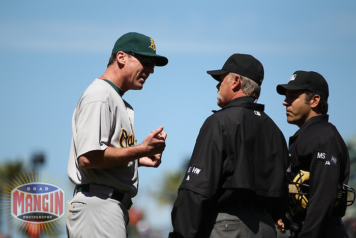 SAN FRANCISCO, CA - MAY 19:  Manager Bob Melvin #6 of the Oakland Athletics argues with umpires Jim Joyce (middle) and James Hoye during the game against the San Francisco Giants at AT&T Park on Saturday, May 19, 2012 in San Francisco, California. Photo by Brad Mangin