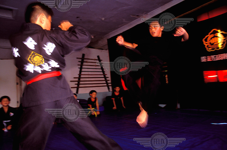 ©Chris Stowers / Panos Pictures..Cheju City, SOUTH KOREA..Children at a martial arts school.