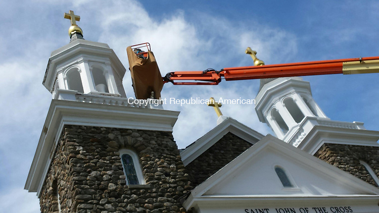MIDDLEBURY, CT: 03 June 2015:060315BB01: MIDDLEBURY --- A crew from D'Ambrosio Ecclesiastical Art Studios, Inc., a Mount Kisco, N.Y., company specializing in the restoration of religious buildings, adds fresh coats of white paint to the towers above St. John of the Cross Church, 1321 Whittemore Road, and gold to the crosses. Bill Bittar Republican-American