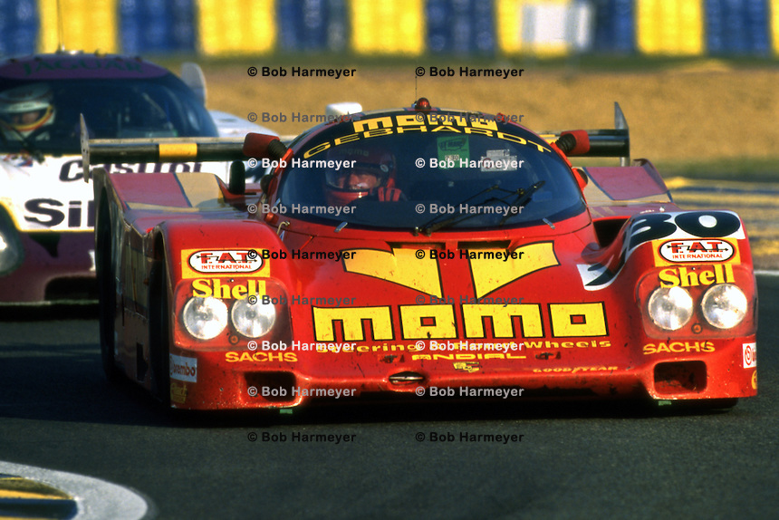LE MANS, FRANCE - JUNE 17: Gianpiero Moretti drives the MOMO Gebhardt Racing Porsche 962C 001GS during the 24 Hours of Le Mans at the Circuit de la Sarthe in Le Mans, France on June 17, 1990.