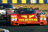 LE MANS, FRANCE - JUNE 17: Gianpiero Moretti drives the MOMO Gebhardt Racing Porsche 962C 001GS during the 24 Hours of Le Mans at the Circuit de la Sarthe in Le Mans, France on June 17, 1990.