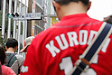 Hiroshima Carp baseball team fans line up along to the main street of Tokyo's Ginza shopping district to enter to Hiroshima Brand Shop TAU on September 11, 2016, Tokyo, Japan. Hundreds of Carps fans lined up from early morning outside Hiroshima Brand Shop TAU to buy victory t-shirts after Hiroshima baseball team got its first Central League title in 25 years after beating the Yomiuri Giants 6-4 on Saturday, September 10. (Photo by Rodrigo Reyes Marin/AFLO)