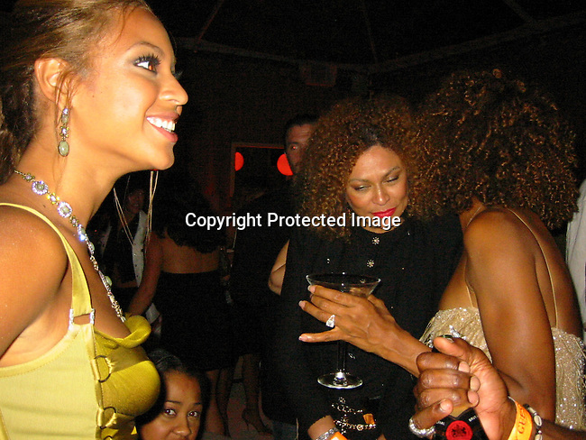 Beyonce Knowles with her mother & Maya.Sean P. Diddy Combs and Ron Burkle Present The Return of Gatsby .2003 MTV Movie Awards Post Party.Ron Burkle Beverly Hills Mansion.Los Angeles, Beverly Hills, CA.Saturday, May 31, 2003.Sales at Celebrityvibe.com/Photovibe.com