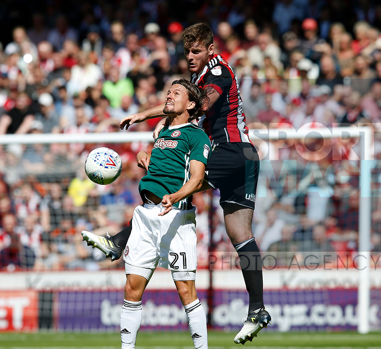 Jack O'Connell of Sheffield Utd and Lasse Vibe of Brentford during the English Championship League match at Bramall Lane Stadium, Sheffield. Picture date: August 5th 2017. Pic credit should read: Simon Bellis/Sportimage