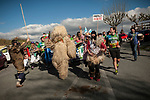 "The bear (an iconic figure of Erratzu carnival) carries the baton as people run on the 20th Korrika. Erratzu (Basque Country) April 3, 2017. The ""Korrika"" is a relay course, with a wooden baton that passes from hand to hand without interruption, organised every two years in a bid to promote the basque language. The Korrika runs over 11 days and 10 nights, crossing many Basque villages and cities, totalling some 2300 kilometres. Some people consider it an honour to carry the baton with the symbol of the Basques, ""buying"" kilometres to support Basque language teaching. (Gari Garaialde / Bostok Photo)"