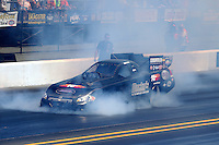 Jul. 26, 2014; Sonoma, CA, USA; Smoke comes from beneath the body of NHRA funny car driver John Hale during qualifying for the Sonoma Nationals at Sonoma Raceway. Mandatory Credit: Mark J. Rebilas-