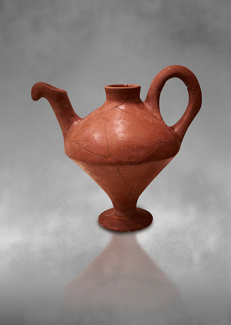 Hittite terra cotta side spouted teapot . Hittite Period, 1600 - 1200 BC.  Hattusa Boğazkale. Çorum Archaeological Museum, Corum, Turkey. Against a grey bacground.