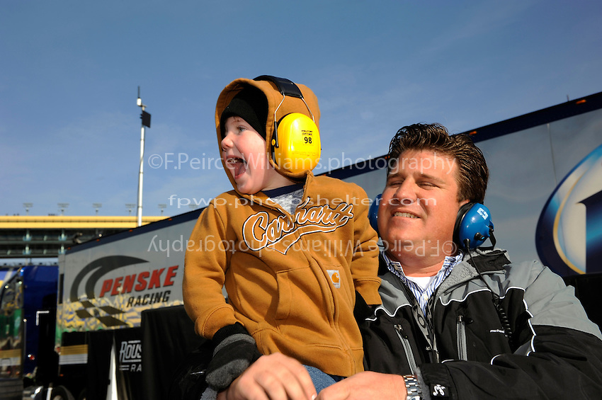 A young fan enjoys the cars.