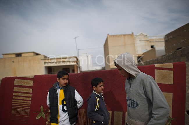 © Remi OCHLIK/IP3 - Sidi Bouzid Tunisia the 20 january 2011 - Daily life in the neighbourhood of Mohamed Bouazizi..When Mohamed Bouazizi set himself alight on Dec. 17, he sparked flames far greater than the ones that would ultimately kill him. The Tunisian man, an unemployed college graduate with children to feed, had tried finding work hawking vegetables, but was thwarted by police, who confiscated his cart. So in a grisly act of protest and anguish, Bouazizi doused himself in gasoline and set himself ablaze...The act of self-immolation not only triggered the current political crisis in Tunisia, which ousted the president Jan. 14 and has led to a complicated political impasse. It also inspired copycat self-immolations across North Africa, who attempted this very sensational form of suicide as statements of their own desperation and frustration with the authoritarian regimes in their countries. The latest count of protesters who have set themselves on fire in North Africa is up to eight, with four in Algeria, two in Egypt and one in Mauritania, as well as Bouazizi's act in Tunisia...