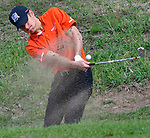 Webster Groves golfer Drew Schwager hits out of a bunker at the 14th hole. Golfers in Suburban Central and Suburban XII Conference schools competed in a tournament at the Gateway National Golf Course in Madison, Illinois on Wednesday April 25, 2018.  Tim Vizer | Special to STLhighschoolsports.com