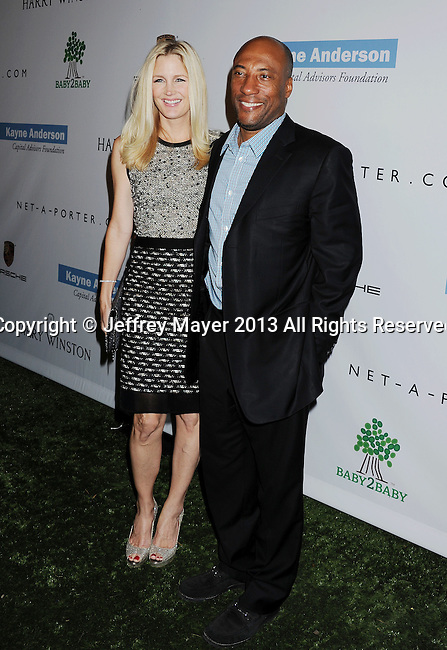 CULVER CITY, CA- NOVEMBER 09: Producer Byron Allen (R) and wife Jennifer Lucas arrive at the 2nd Annual Baby2Baby Gala at The Book Bindery on November 9, 2013 in Culver City, California.