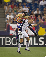 Monarcas Morelia defender Mauricio Romero (26) and New England Revolution forward Ilija Stolica (9) battle for head ball. Monarcas Morelia defeated the New England Revolution, 2-1, in the SuperLiga 2010 Final at Gillette Stadium on September 1, 2010.