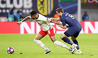 10th March 2020, Red Bull Arena, Leipzig, Germany; EUFA Champions League, RB Leipzig v Tottenham Hotspur;  Christopher Nkunku of RB Leipzig held by Harry Winks of Tottenham.