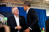United States President Barack Obama shakes hands with Terry McAuliffe, left, at a campaign event for McAuliffe at Washington-Lee High School, Arlington, Virginia, U.S., on Sunday, November 3, 2013. McAuliffe is the Democratic nominee in the 2013 Virginia gubernatorial election. <br /> Credit: Pete Marovich / Pool via CNP