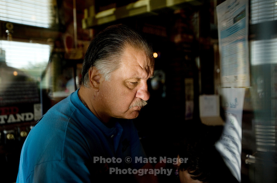 Owner of The Loop Taste of Chicago, Mark Rusin (cq) at his restaurant in Tucson, Arizona, Thursday, August 6, 2009. Rusin was denied a small business emergency loan designed to help people as part of the stimulus package...PHOTOS/ MATT NAGER