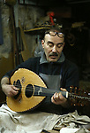 """Palestinian nurse, Ali Hassanin, 57, who makes lutes, known in Arabic as an """"Oud"""", works on a musical instrument, at his workshop, in the West Bank city of Nablus on November 26, 2018. Photo by Shadi Jarar'ah"""