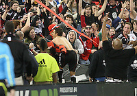 Josh Wolfe#16 of D.C. United with the fans after scoring during the opening match of the 2011 season against the Columbus Crew at RFK Stadium, in Washington D.C. on March 19 2011.D.C. United won 3-1.