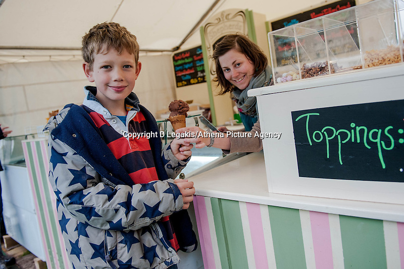 Thursday  29 May 2014, Hay on Wye, UK<br /> Pictured: ( L-R )  Will Quibell from Eastborne tucks into a Cocolate Icecream from Sheppards. Serving him is Lizi Stockley<br /> Re: The Hay Festival, Hay on Wye, Powys, Wales UK.