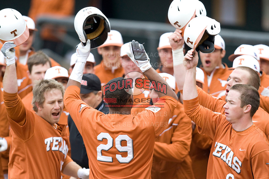 Texas bench meets Kevin Keyes (#29) after he hit a grand slam against the Stanford Cardinal at  UFCU Disch-Falk Field in Austin, Texas on Friday February 26th, 2100.  (Photo by Andrew Woolley / Four Seam Images)