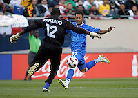 Cuba goalkeeper Julio Ramos Pichardo comes out to kick the ball away from oncoming El Salvador shooter Lester Blanco.  El Salvador defeated Cuba 6-1 at the 2011 CONCACAF Gold Cup at Soldier Field in Chicago, IL on June 12, 2011.