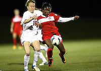BOYDS, MARYLAND - April 06, 2013:  Jasmyne Spencer (20) of The Washington Spirit battles for the ball with Emily Sonnett (16) of the University of Virginia women's soccer team in a NWSL (National Women's Soccer League) pre season exhibition game at Maryland Soccerplex in Boyds, Maryland on April 06. Virginia won 6-3.