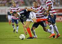 May 26, 2012:   Scotland Charlie Mulgrew (3) is tripped up by USA Men's National Team Jermaine Jones (13) during action between the USA and Scotland at EverBank Field in Jacksonville, Florida.  USA defeated Scotland 5-1.............