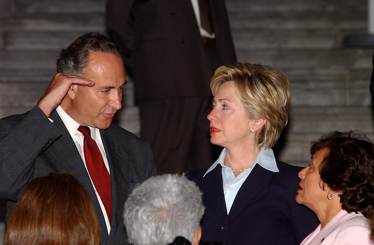 12terrorist091201 -- Charles Schumer, D-N.Y., Hillary Rodham Clinton, D-N.Y., and Nita Lowey, D-N.Y., talk after last nights emotional ceremony to show solidarity in denouncing the act of terrorism on America.