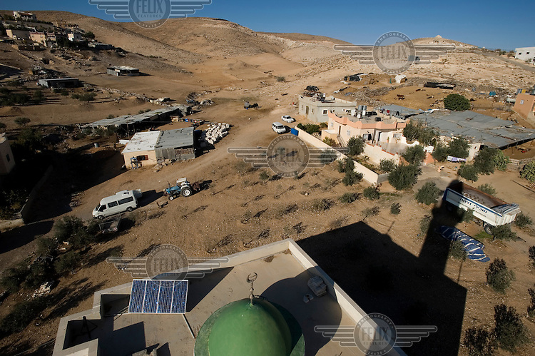 A photovoltaic solar panel provides electricity to the local mosque in the Arab village of Darajat, in Israel's Negev desert..