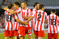 MELBOURNE, AUSTRALIA - MAY 19: Olympiakos players celebrate David Fuster's goal during the match between Melbourne Victory and Olympiakos FC at Etihad Stadium on 19 May 2012 in Melbourne, Australia. (Photo Sydney Low / AsteriskImages.com)