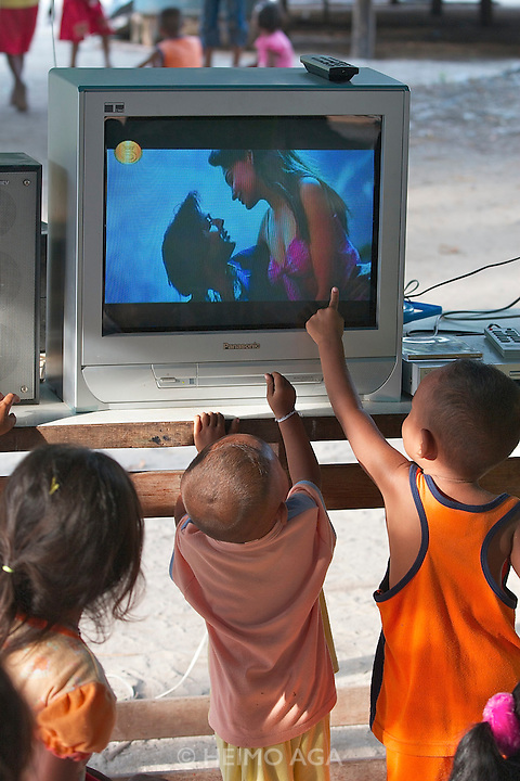 Kids watching sex scenes a Bollywood movie.