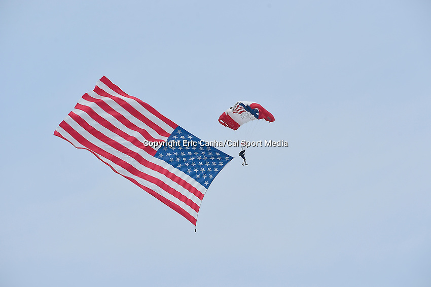 July 13, 2014 - Loudon, New Hampshire, U.S. - A member of Team Fastrax parachutes onto the field before the start of the NASCAR Sprint Cup Series Camping World RV 301 race held at the New Hampshire Motor Speedway in Loudon, New Hampshire. Eric Canha/CSM