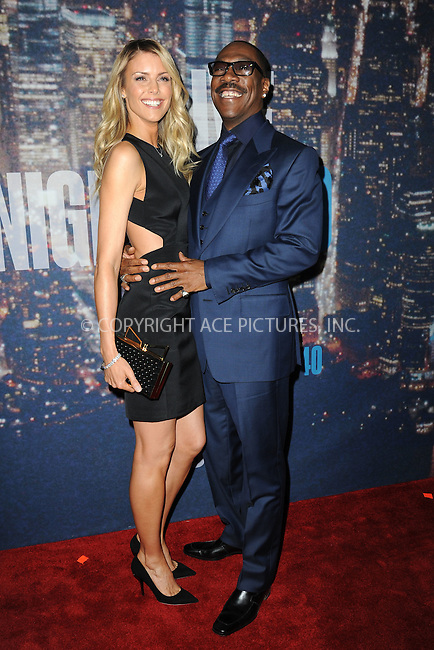 WWW.ACEPIXS.COM<br /> February 15, 2015 New York City<br /> <br /> Paige Butcher and Eddie Murphy walking the red carpet at the SNL 40th Anniversary Special at 30 Rockefeller Plaza on February 15, 2015 in New York City.<br /> <br /> Please byline: Kristin Callahan/AcePictures<br /> <br /> ACEPIXS.COM<br /> <br /> Tel: (646) 769 0430<br /> e-mail: info@acepixs.com<br /> web: http://www.acepixs.com