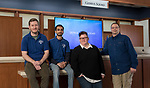 Left to right, Justin Smith and Neel Patel, Genius Squad student technicians, Marlyece Blum, Genius Squad team lead in the Lincoln Park Campus, and Robert Kamka, Genius Squad team lead in the Loop Campus, Wednesday, March 8, 2018, in the Richardson Library. DePaul's Genius Squad provides technical service and support for desktops, laptops, phones, tablets, and other personal electronic devices to all faculty, staff and students. The Genius Squad has locations at both the Lincoln Park and Loop campuses.​​​​ (DePaul University/Jeff Carrion)