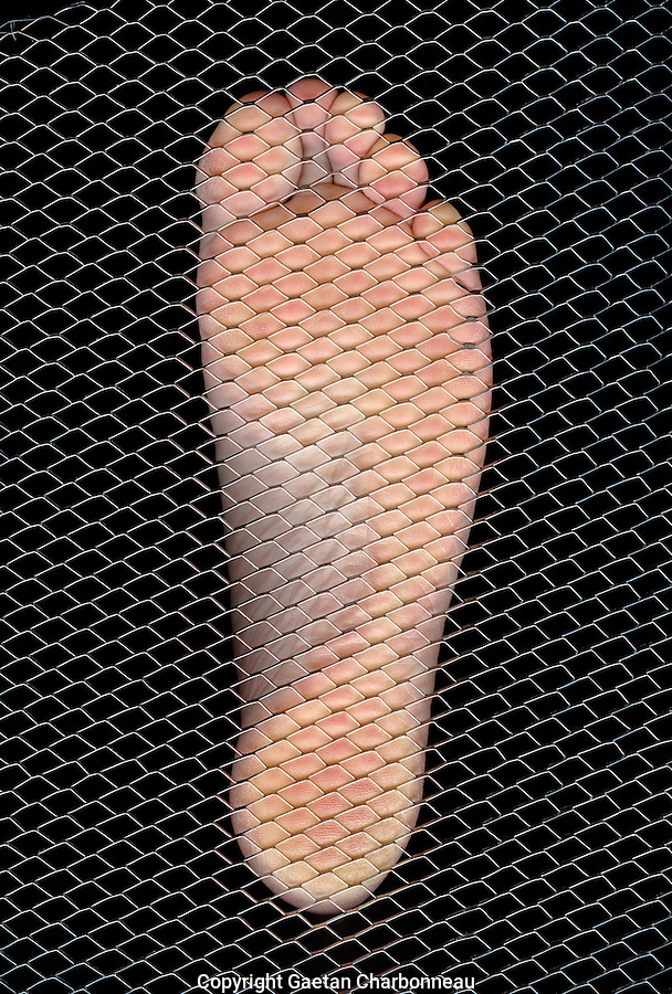 Man foot on metal grid