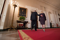 US President Donald J. Trump (L) walks in the Cross Hall from the East Room, with Kirstjen Nielsen (R), after announcing her as his nominee for the position of Secretary of Homeland Security, at the White House in Washington, DC, USA, 12 October 2017.<br /> Credit: Michael Reynolds / Pool via CNP /MediaPunch