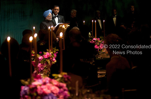 Washington, DC - November 24, 2009 -- Manmohan Singh, India's prime minister, left, and United States President Barack Obama, speak during the State Dinner on the South Lawn of the White House in Washington, D.C., U.S., on Tuesday, November 24, 2009. Obama welcomed India's role as a rising and responsible global power, saying the U.S. will follow through on a civilian nuclear agreement and work to expand trade and investment ties with the world's largest democracy. .Credit: Andrew Harrer - Pool via CNP