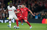 Benjamin Pavard of Bayern Munich & Moussa Sissoko of Spurs during the UEFA Champions League group match between Tottenham Hotspur and Bayern Munich at Wembley Stadium, London, England on 1 October 2019. Photo by Andy Rowland.