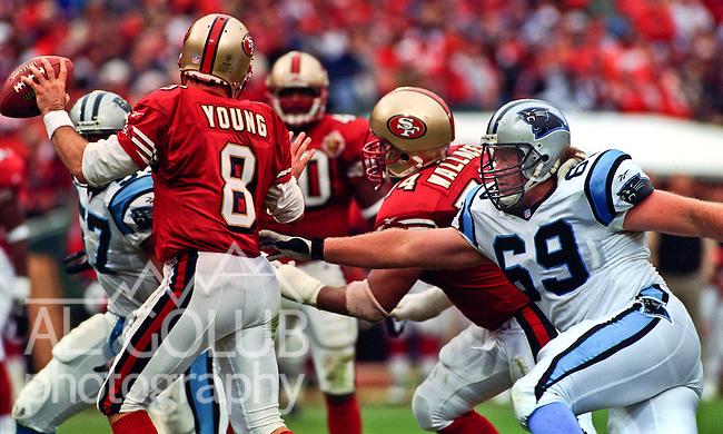 San Francisco 49ers vs. Carolina Panthers at Candlestick Park Sunday, December 8, 1996.  Panthers beat 49ers  30-24.  Carolina Panthers nose tackle Les Miller (69) rushes San Francisco 49ers quarterback Steve Young (8).