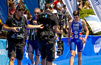 27 MAY 2012 - MADRID, ESP - Jonathan Brownlee (GBR) of Great Britain is filmed by a television crew after taking a warm up swim before the elite men's 2012 World Triathlon Series round in Casa de Campo, Madrid, Spain (PHOTO (C) 2012 NIGEL FARROW)